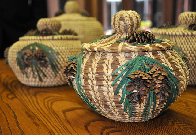 Photograph from the summer of 2011 in Texas. Alabama-Coushatta Tribe of Texas creating longleaf pine needle baskets. (Photographer: Beverly Moseley, Public Affairs Specialist, USDA-NRCS. Coutrtesy of NRCS and the National Agroforestry Center www.unl.edu/nac/).